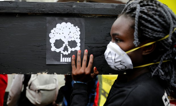 A campaigner in Nairobi carries a coffin during a protest against the construction of a coal plant in Lamu on Kenya's coast. Photograph: Baz Ratner/Reuters